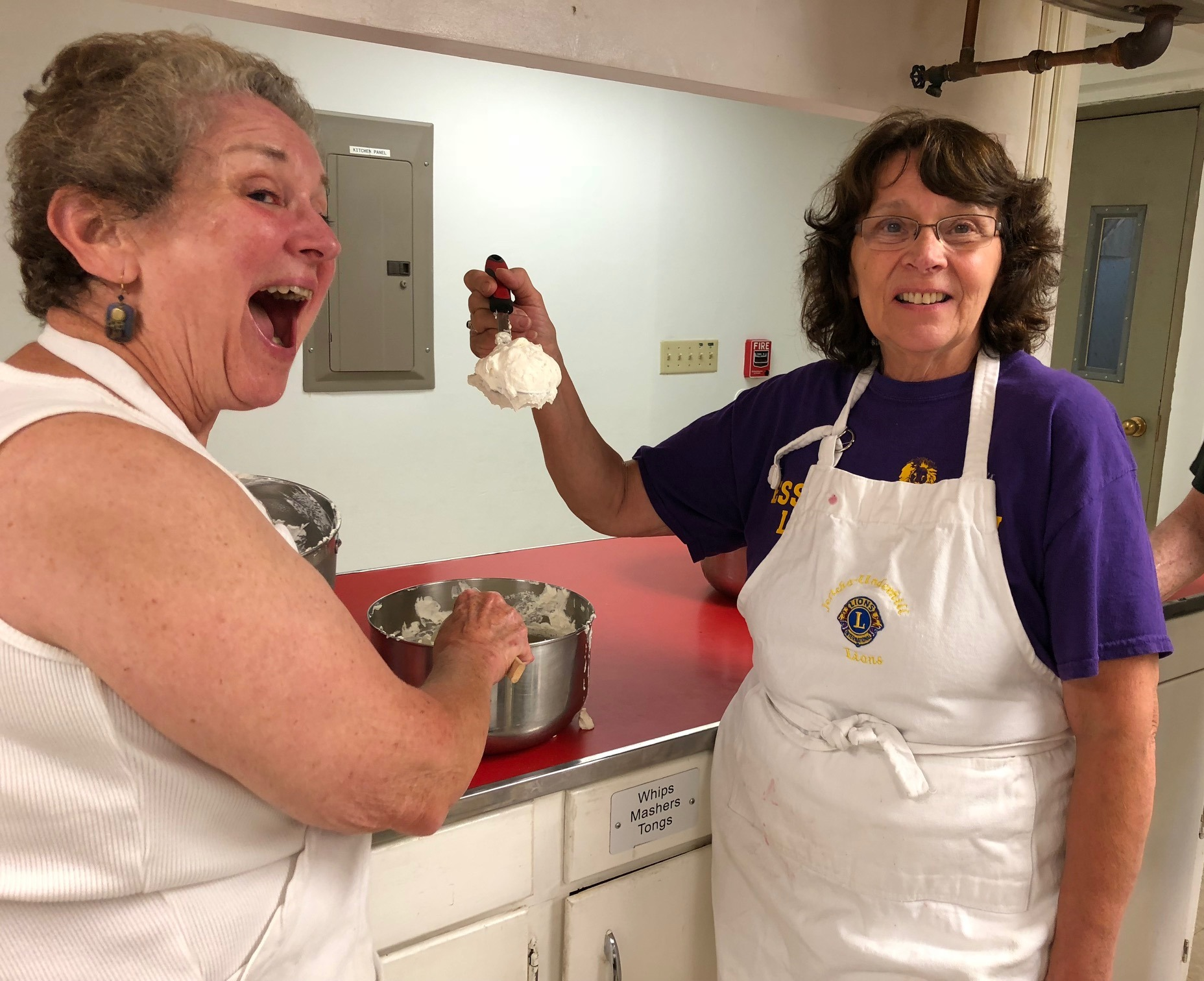 Marge Alden and Betsy MaGee prepare for taste test